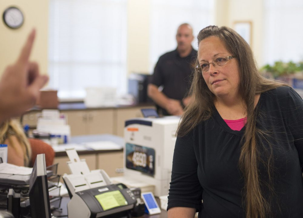 Kim Davis, the Rowan County Clerk of Courts, listens to Robbie Blankenship and Jesse Cruz as they speak with her about getting a marriage license at the County Clerks Office on September 2, 2015 in Morehead, Kentucky. Citing a sincere religious objection, Davis, an Apostolic Christian, has refused to issue marriage licenses to same sex couples in defiance of a Supreme Court ruling. (Ty Wright/Getty Images)