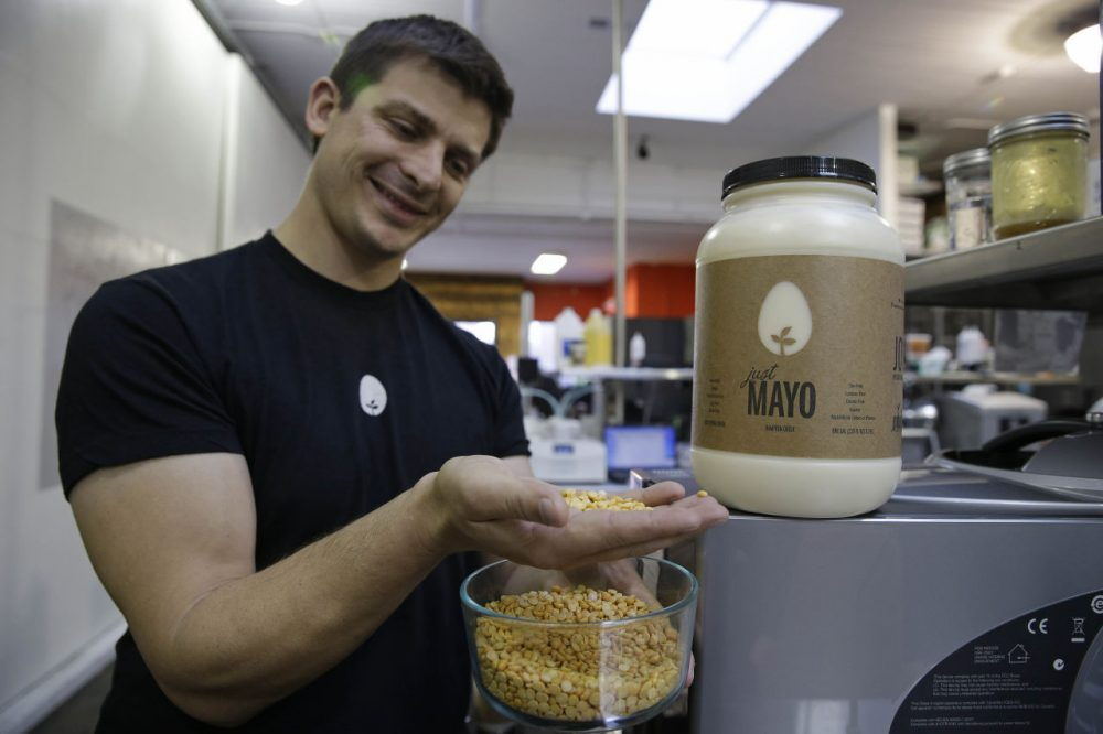 Hampton Creek Foods CEO Josh Tetrick holds a species of yellow pea used to make Just Mayo, a plant-based mayonnaise, in San Francisco, Dec. 3, 2013. (Eric Risberg/AP)