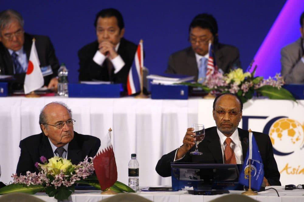Sepp Blatter (left) with Mohamed bin Hammam (right) (Mark Baker/AP)