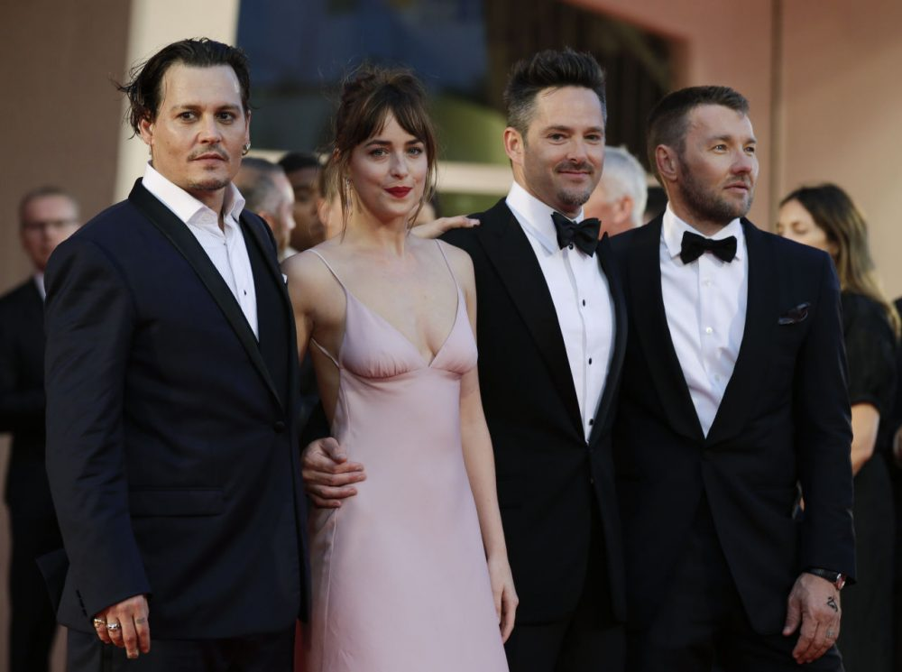"From left, actors Johnny Depp, Dakota Johnson, director Scott Cooper and actor Joel Edgerton at the screening of the movie ""Black Mass"" at the Venice Film Festival in Italy on Sept. 4 (Andrew Medichini/AP)"