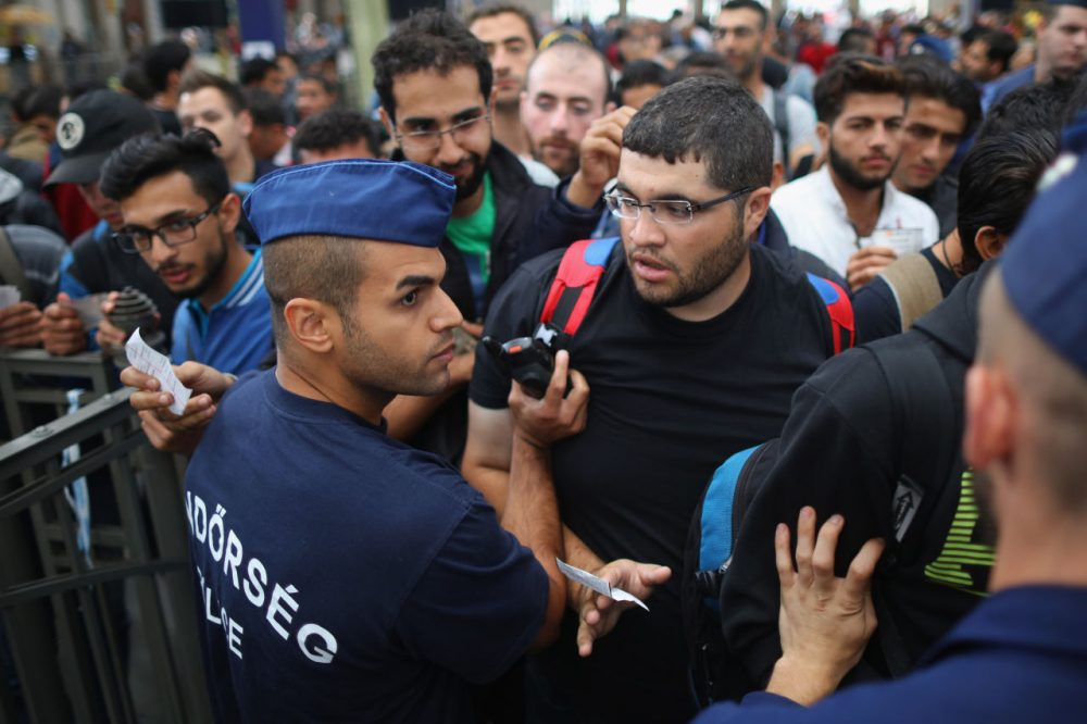 Migrants queue to board a train to Vienna at Keleti station on September 7, 2015 in Budapest, Hungary. As the migrant crisis in Europe continues an estimated 18,000 people arrived in Germany over the weekend with thousands more following in their wake along the Balkan route. (Christopher Furlong/Getty Images)