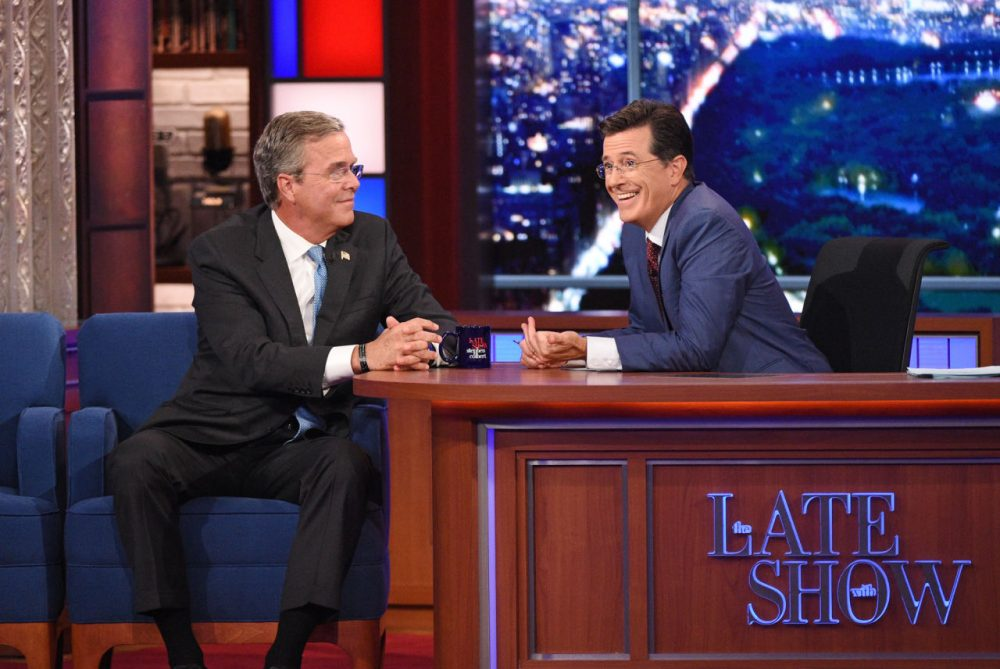 "Stephen Colbert, right, talks with Republican presidential candidate Jeb Bush during the premiere episode of ""The Late Show,"" Tuesday Sept. 8, 2015, in New York. Bush and actor George Clooney were the guests for Colbert's debut. (Jeffrey R. Staab/CBS via AP)"