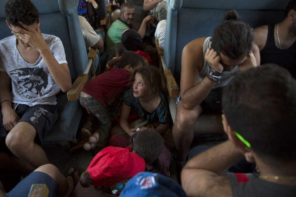 Migrant families ride a train from Gevgelija to the Serbian border on September 4, 2015 in Macedonia. After stopping at a Serbian processing facility for migrants only, most people will continue on foot for the next 6 miles into the Serbian town of Preshevo. Since the beginning of 2015 the number of migrants using the so-called 'Balkans route' has exploded with migrants arriving in Greece from Turkey and then travelling on through Macedonia and Serbia before entering the EU via Hungary. The number of people leaving their homes in war torn countries such as Syria, marks the largest migration of people since World War II. (Dan Kitwood/Getty Images)
