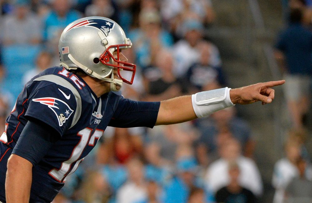 Tom Brady #12 of the New England Patriots reads the Carolina Panthers defense in the 1st quarter during their preseason NFL game at Bank of America Stadium on August 28, 2015 in Charlotte, North Carolina. (Grant Halverson/Getty Images)