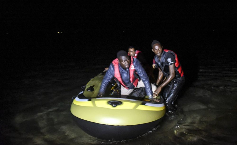 African migrants board a boat to the Greek island of Kos on early August 15, 2015 off the shore of Bodrum, southwest Turkey. Authorities on the island of Kos have been so overwhelmed that the government sent a ferry to serve as a temporary centre to issue travel documents to Syrian refugees - among some 7,000 migrants stranded on the island of about 30,000 people. (Bulent Kilic/AFP/Getty Images)
