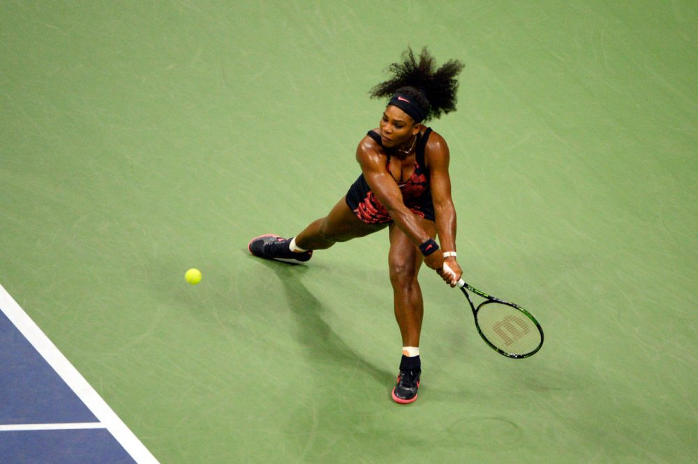 Serena Williams of the United States returns a shot to Venus Williams of the United States during their Women's Singles Quarterfinals match on Day Nine of the 2015 U.S. Open at the USTA Billie Jean King National Tennis Center on September 8, 2015 in the Flushing neighborhood of the Queens borough of New York City. (Alex Goodlett/Getty Images)
