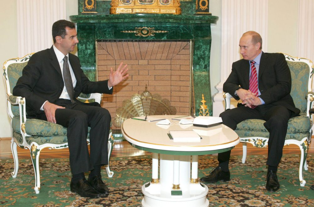 Russian President Vladimir Putin, right, listens to his Syrian counterpart Bashar Assad during a meeting in Moscow's Kremlin, Tuesday, Dec. 19, 2006. Putin hosted his Syrian counterpart for talks focusing on tensions among the Palestinians, Lebanon's political standoff and the stalled Middle East peacemaking - part of Moscow's efforts to bolster its role in the region amid escalating crises. (Sergei Karpukhin/AP)