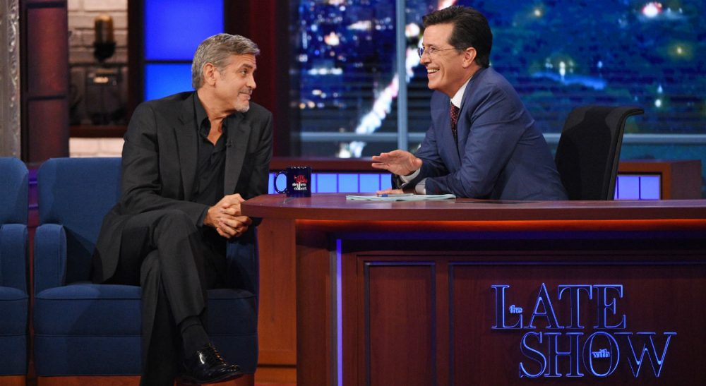 "Stephen Colbert, right, talks with actor George Clooney during the premiere episode of ""The Late Show,"" Tuesday Sept. 8, 2015, in New York. Clooney and Republican presidential candidate Jeb Bush were the guests for Colbert's debut. (Jeffrey R. Staab/CBS via AP)"