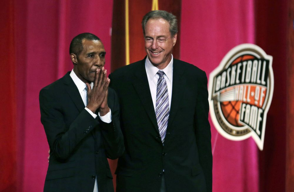 Basketball Hall of Fame inductee Jo Jo White pauses to acknowledge applause during the enshrinement ceremony for the Class of 2015 of the Naismith Memorial Basketball Hall of Fame in Springfield on Friday. At right is White's Boston Celtics teammate, Hall of Famer Dave Cowens. (Charles Krupa/AP)