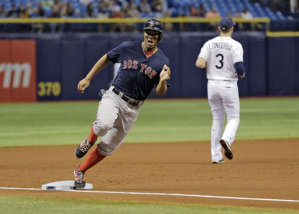 Boston Red Sox's Xander Bogaerts races home on an RBI double by David Ortiz during the first inning.  (Chris O'Meara/AP)