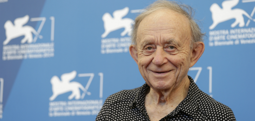 "Cambridge-based documentarian Frederick Wiseman is debuting ""In Jackson Heights"" as well as a ballet based on his renowned ""Titicut Follies"" at this year's Toronto International Film Festival. He appears in this photo during the 2014 Venice Film Festival. (David Azia/AP)"