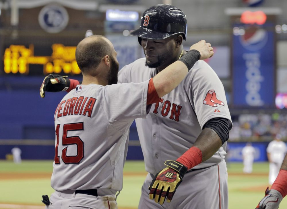 Boston Red Sox's David Ortiz, right, hugs Dustin Pedroia after Ortiz hit his 500th career home run off Tampa Bay Rays starting pitcher Matt Moore during the fifth inning Saturday in St. Petersburg, Fla. (Chris O'Meara/AP)