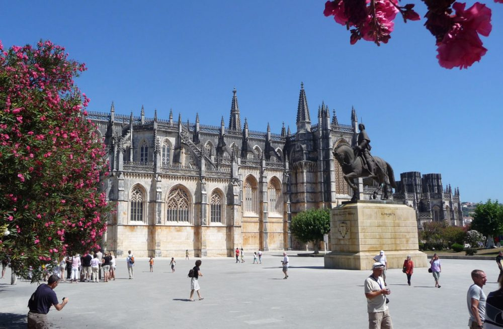 """Tourists visit the Monastery of Batalha in Batalha, Portugal. The town's name means """"battle."""" (suhajdab/Flickr)"""
