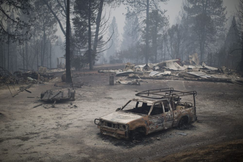A burned truck and structures are seen at the Butte Fire on September 13, 2015 near San Andreas, California. California governor Jerry Brown has declared a state of emergency in Amador and Calaveras counties where the 100-square-mile wildfire has burned scores of structures so far and is threatening 6,400 in the historic Gold Country of the Sierra Nevada foothills. (David McNew/Getty Images)