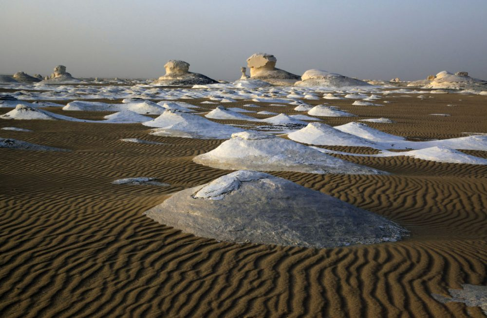 The Egyptian White desert, about 310 miles southwest of Cairo, Egypt, is pictured on May 19, 2013. At least 12 people were killed and 10 injured in Egypt's southwestern desert Sunday, Sept 13, 2015, when security forces mistakenly fired on a group of Mexican tourists, Egyptian officials said. The Mexican Foreign Ministry confirmed the incident and said at least two of the dead were Mexican nationals. (Manoocher Deghati/AP)
