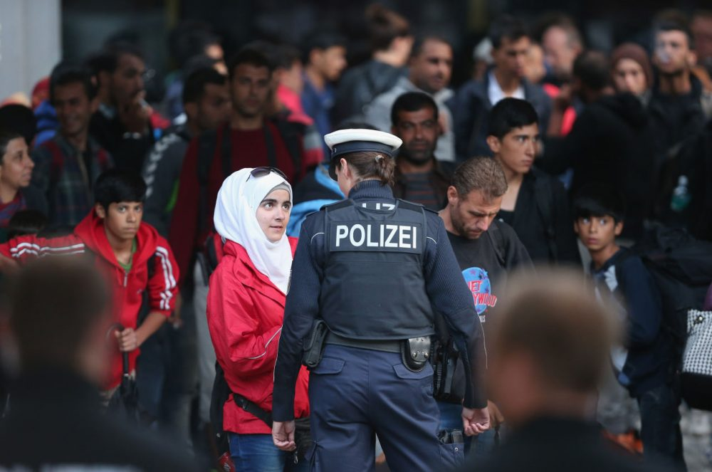 Migrants arrive from Hungary at the Munich Hauptbahnhof main railway station on September 5, 2015 in Munich, Germany. (Sean Gallup/Getty)