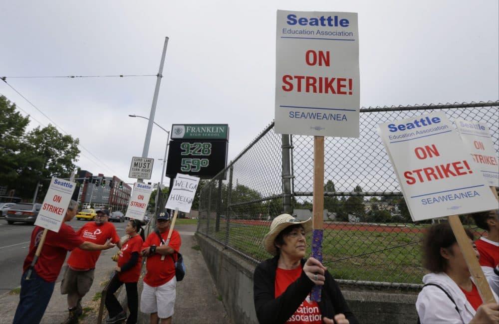 Striking Seattle School District teachers and other educators walk a picket line, Thursday, Sept. 10, 2015, near Franklin High School in Seattle. (Ted S. Warren/AP)