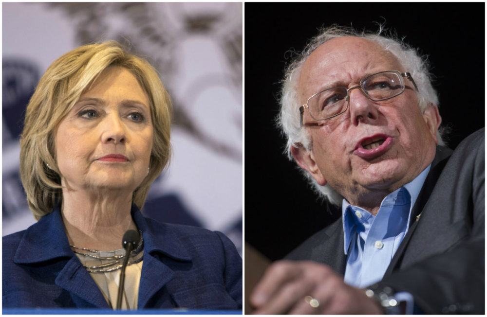 WBUR's poll of the likely voters in the New Hampshire Democratic presidential primary finds Bernie Sanders, right, leading Hillary Clinton. (Scott Morgan and Cliff Owen/AP)