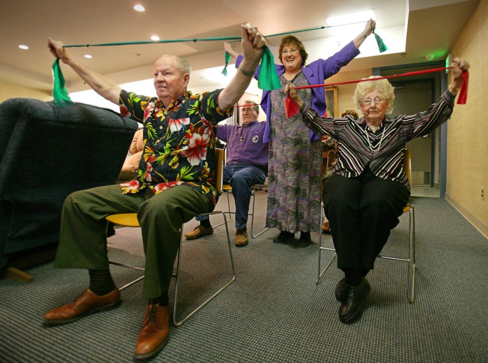 Lynette Sali leads stretching exercises with club members Bob Wecke, Don Willis and Maxinne Read at the Cathedral of the Rockies Methodist Church in downtown Boise, Idaho. Their club provides activities for those suffering from dementia and Alzheimer's. (Troy Maben/AP)