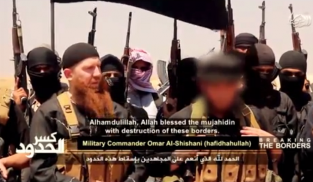 Abu Omar al-Shishani (left) is pictured in this screenshot from an ISIS video posted on the internet.
