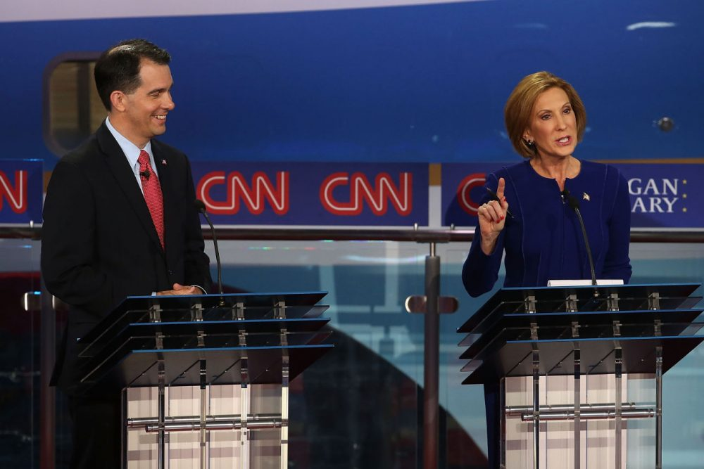 Republican presidential candidate Wisconsin Gov. Scott Walker (L) looks on as Carly Fiorina speaks during the presidential debates at the Reagan Library on September 16, 2015 in Simi Valley, California.  (Justin Sullivan/Getty Images)