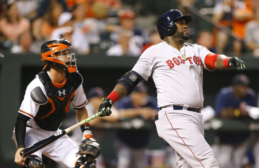 Red Sox's David Ortiz, right, watches his solo home run in front of Orioles catcher Caleb Joseph, Wednesday, Sept. 16, 2015, in Baltimore. (Patrick Semansky/AP)