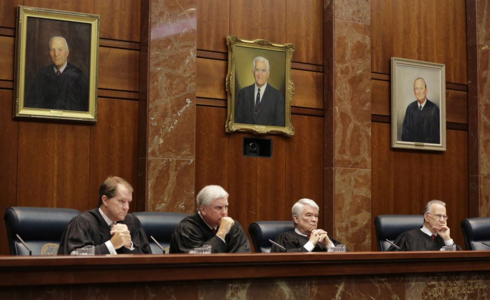Texas Supreme Court Justices  listen to oral arguments in Texas' latest school finance trial at the state Supreme Court, Tuesday, Sept. 1, 2015, in Austin, Texas. Attorneys for more than 600 school districts suing Texas argue that the funding is inadequate and unfairly distributed, making it hard for students and schools to meet stringent academic standards.  (Eric Gay/Pool/AP Images)