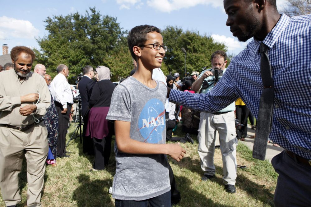 Ahmed Mohamed, 14, is greeted by a supporter during a news conference on Wednesday in Irving, Texas. He was detained after a high school teacher falsely concluded that a homemade clock he brought to class might be a bomb. (Ben Torres/Getty Images)