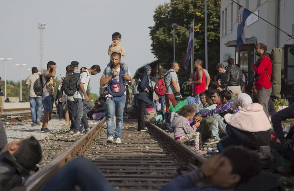 Refugees gather at the train station in Beli Manastir, near the Hungarian border, in northeast Croatia, early Friday. (Darko Bandic/AP)