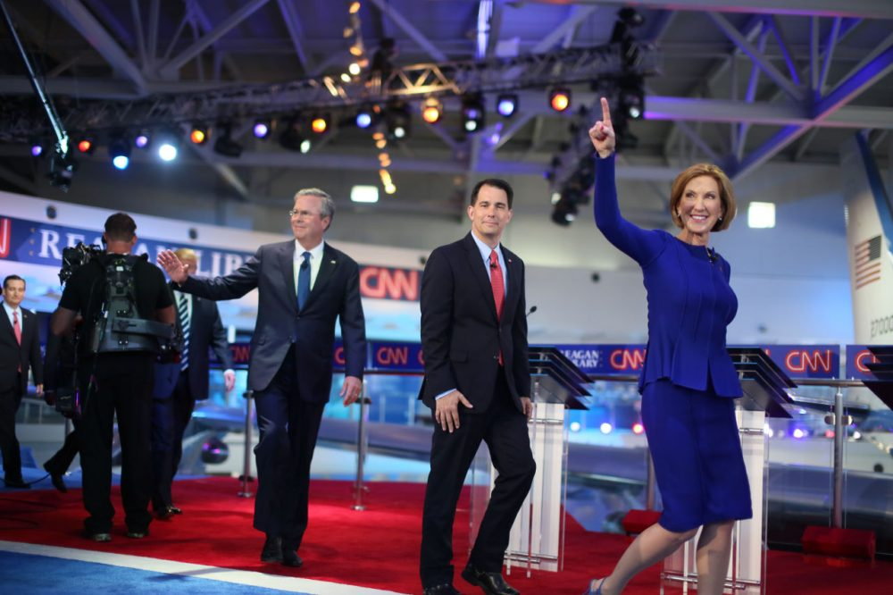 Republican presidential candidates (right to left) Carly Fiorina, Wisconsin Gov. Scott Walker and Jeb Bush walk onstage for the GOP debate on Wednesday night. (Sandy Huffaker/Getty Images)