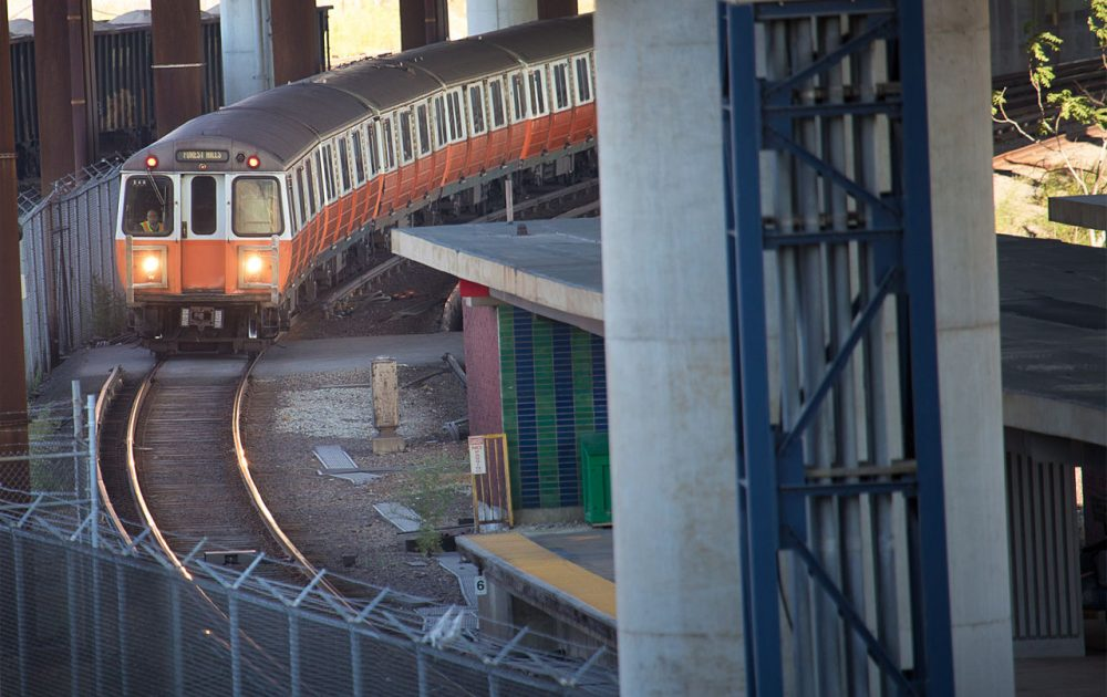 An Orange Line train pulls into Community College Station in Charlestown. The MBTA's operating expenses and debt service, a new report says, are growing at nearly three times the rate of revenue growth. (Jesse Costa/WBUR)