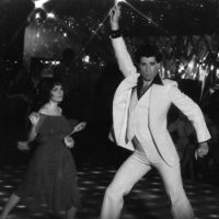 "John Travolta and Karen Gorney dance in a nightclub scene to disco music in the 1977 release of ""Saturday Night Fever."" (HO/AP)"