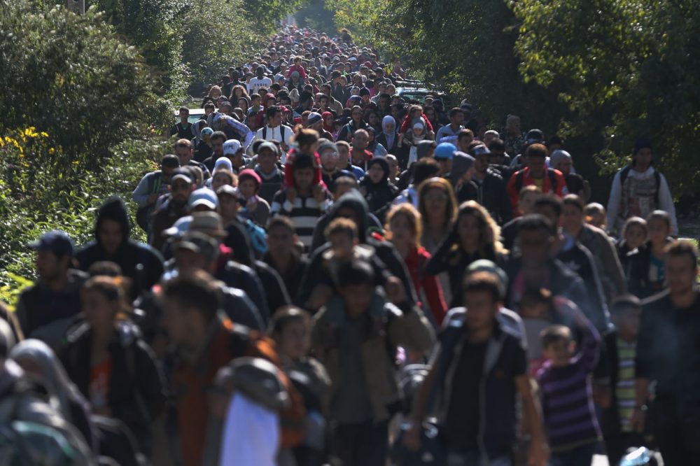 Hundreds of migrants who arrived by train at Hegyeshalom on the Hungarian and Austrian border walk the four kilometers into Austria on September 22, 2015 in Hegyeshalom, Hungary. Politicians across the European Union are holding meetings on the refugee crisis with EU leaders attending a summit on Wednesday to try and solve the crisis and the dispute of how to relocate 120,000 migrants across EU states.  (Christopher Furlong/Getty Images)