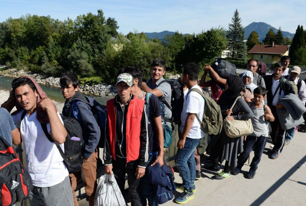 Refugees wait for police controls on a bridge crossing the border between Austria and Germany on Sept. 16, 2015. (Christof Stache/AFP/Getty Images)