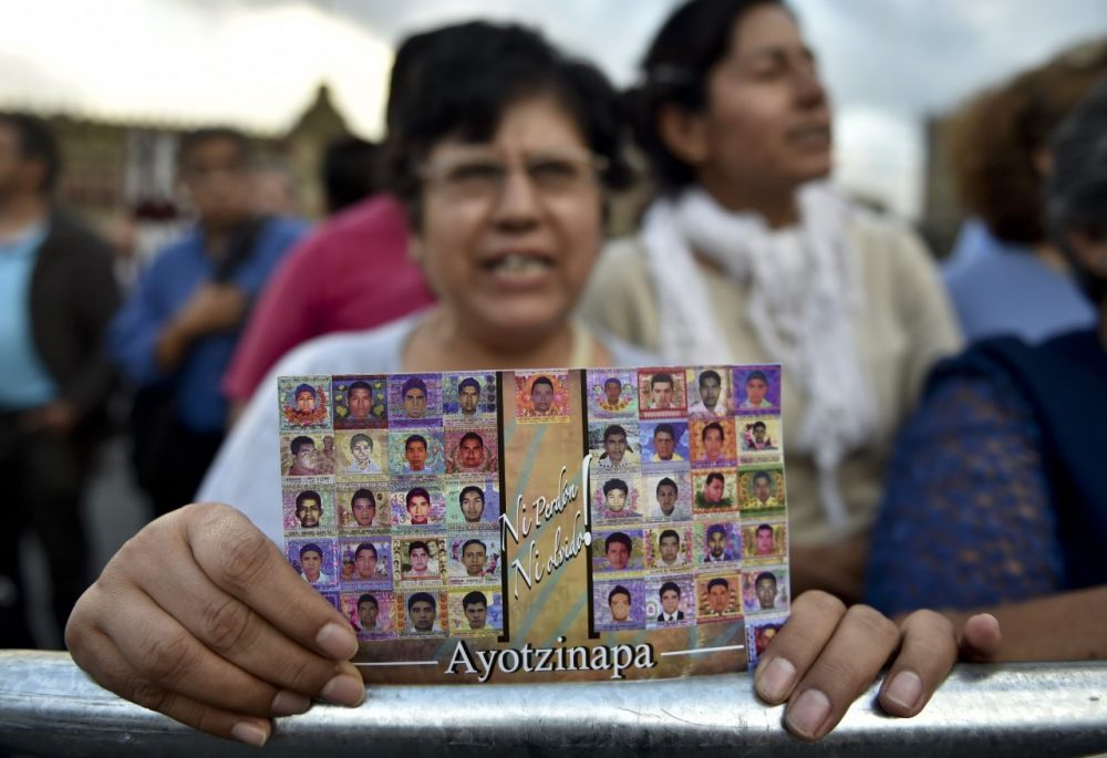 People gathering in Mexico City show their support to parents, relatives and friends of the 43 missing students from a rural teachers college from Ayotzinapa.  (Yuri Cortez/AFP/Getty Images)
