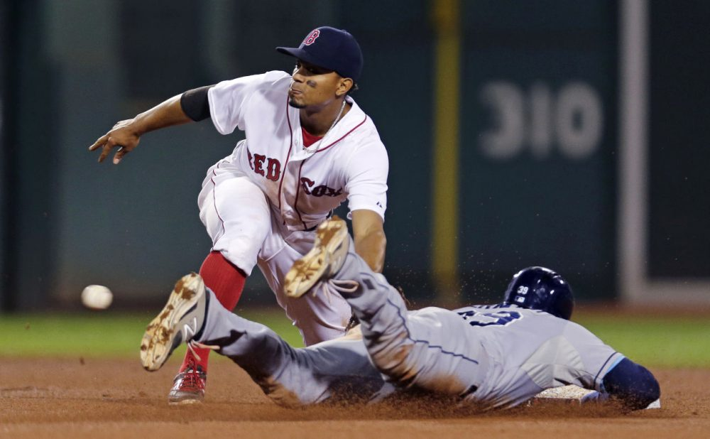 Boston Red Sox shortstop Xander Bogaerts sets to make the tag while catching Tampa Bay Rays' Kevin Kiermaier trying to steal second base at a game at Fenway Park on Thursday. (Charles Krupa/AP)