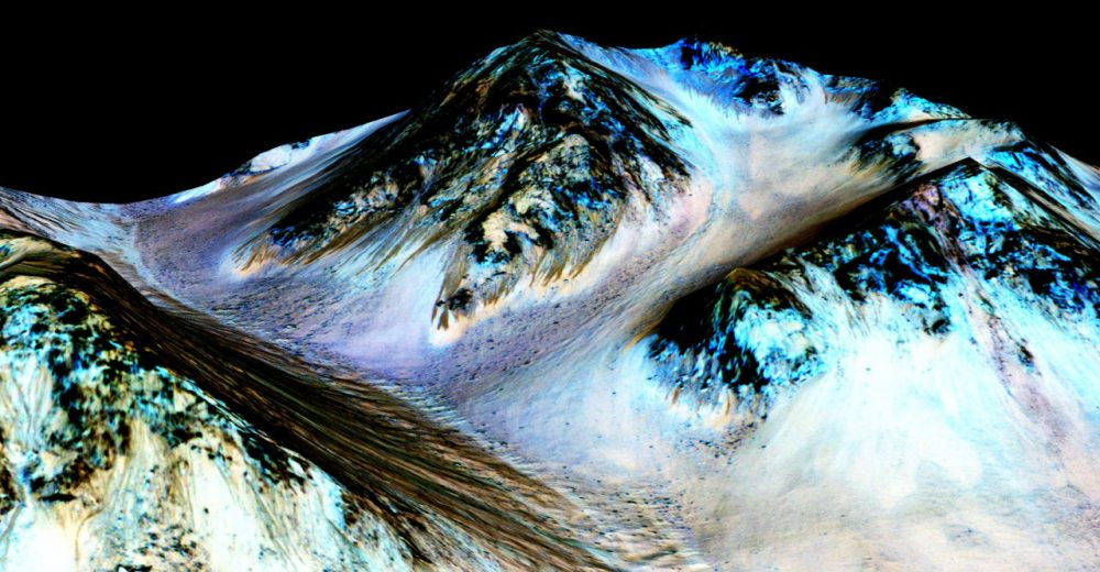 These dark, narrow, 100 meter-long streaks called recurring slope lineae flowing downhill on Mars are inferred to have been formed by contemporary flowing water. (Courtesy NASA/JPL/University of Arizona)