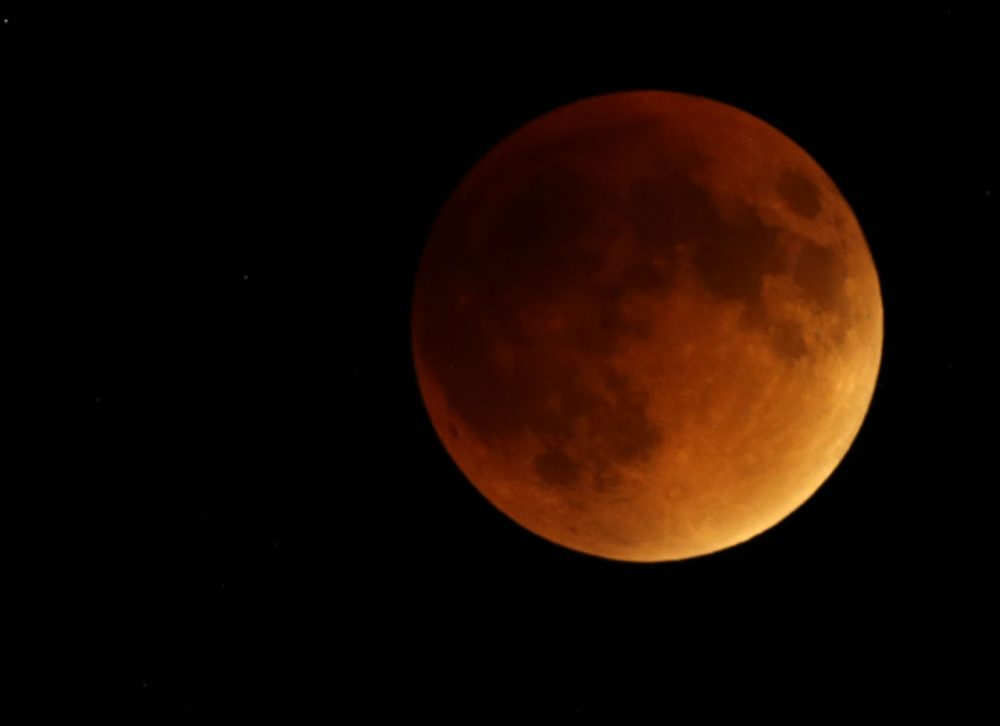 Earth's shadow obscures the view of a so-called supermoon during a total lunar eclipse on Sunday near Lecompton, Kan. (Orlin Wagner/AP)