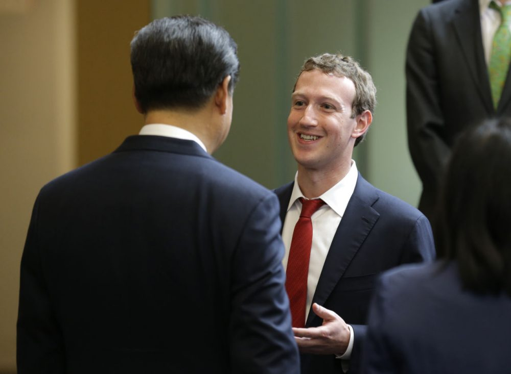 Chinese President Xi Jinping, left, talks with Facebook Chief Executive Mark Zuckerberg, right, during a gathering of CEOs and other executives at Microsoft's main campus September 23, 2015 in Redmond, Washington. Xi and top executives from U.S. and Chinese companies discussed a range of issues, including trade relations, intellectual property protection, regulation transparency and clean energy, according to published reports. (Ted S. Warren/Getty Images)