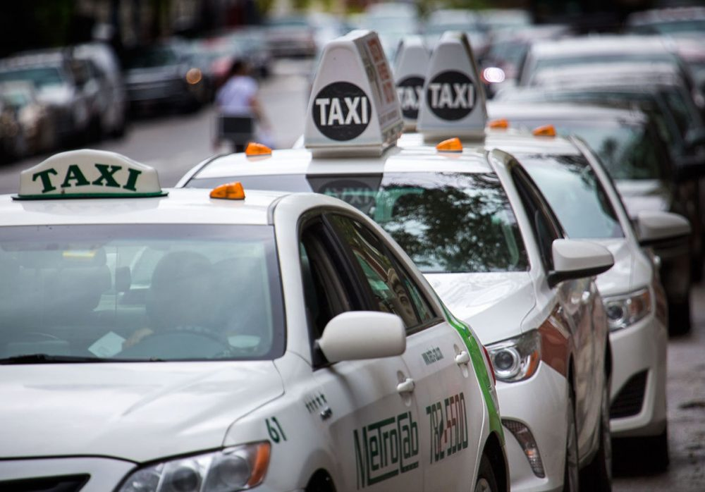 Taxis lined up at a taxi stand on Boylston Street in Boston on Wednesday, Sept. 30, 2015. (Jesse Costa/WBUR)