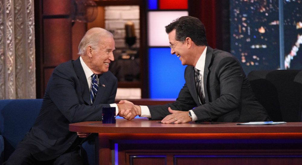 "In this image released by CBS, host Stephen Colbert, right, shakes hands with Vice President Joe Biden during a taping of ""The Late Show with Stephen Colbert,"" on Thursday, Sept. 10, 2015. (AP)"