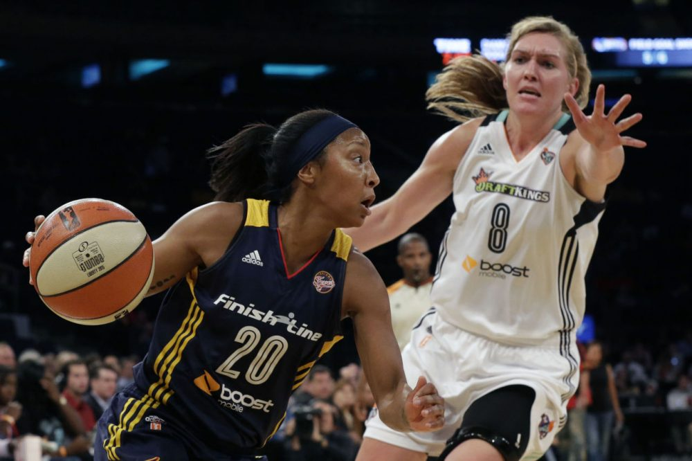 Indiana Fever guard Briann January (20) drives to the basket past New York Liberty center Carolyn Swords (8) during Game 1 of the WNBA basketball Eastern Conference finals on Sept. 23, 2015 at Madison Square Garden in New York.  (Mary Altaffer/AP)