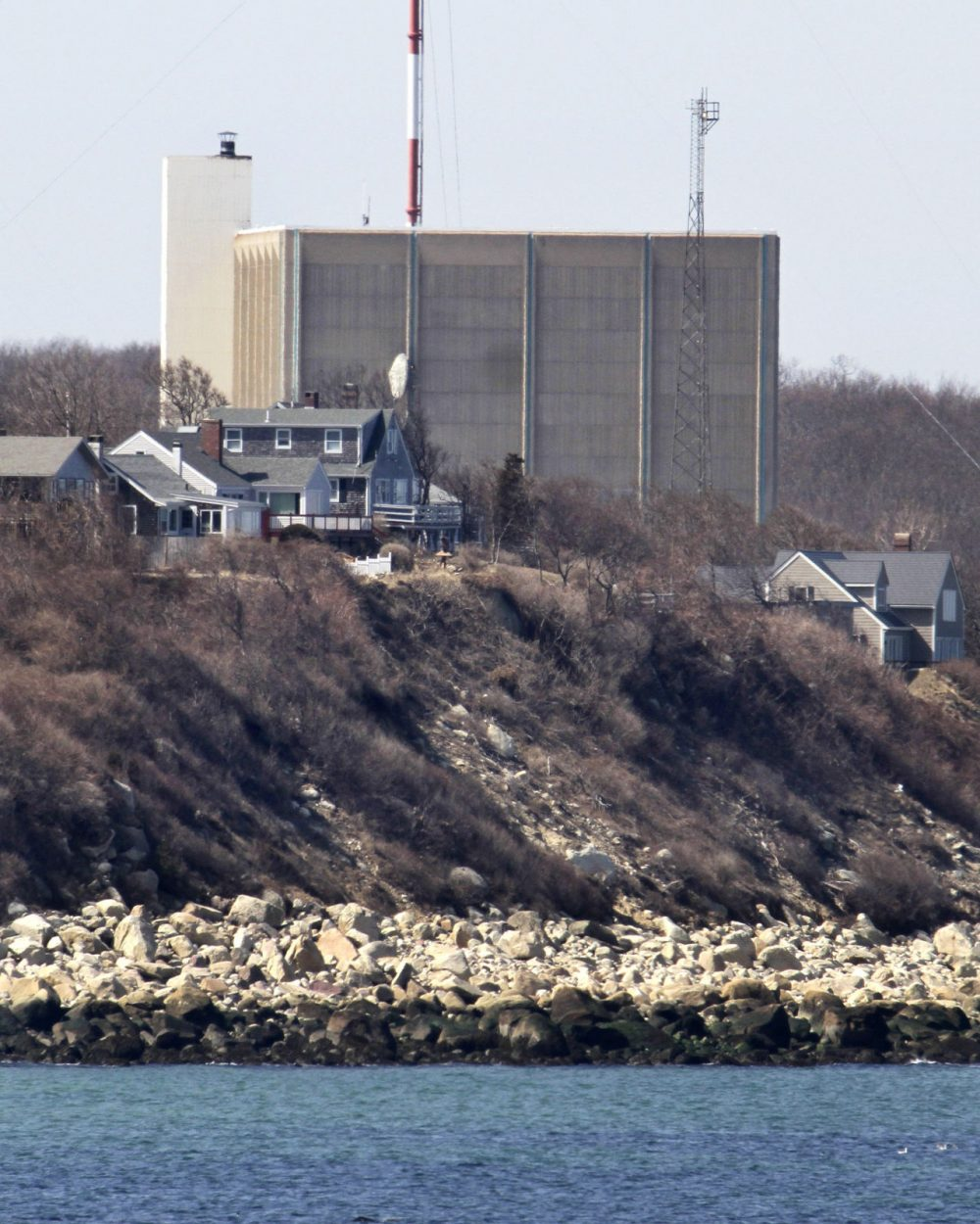 A tower at Pilgrim Nuclear Power Station in Plymouth is seen near the coast of Cape Cod Bay in 2011. (Steven Senne/AP)