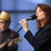 Singer and songwriters Rosanne Cash, right, performs at the John F. Kennedy Library and Museum in June 2014, in Boston. (Steven Senne/AP)