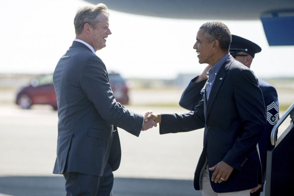 Gov. Charlie Baker greets President Obama at Logan Airport Monday. Obama was in Boston to speak at the the Greater Boston Labor Council's Labor Day breakfast. (Andrew Harnik/AP)