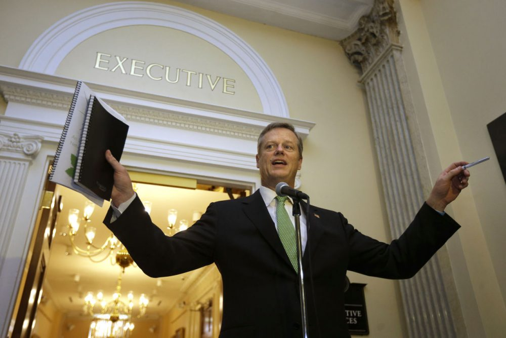 Gov. Charlie Baker speaks with reporters outside his office Wednesday, after discussing the North-South rail link with former Govs. Michael Dukakis and William Weld. (Steven Senne/AP)