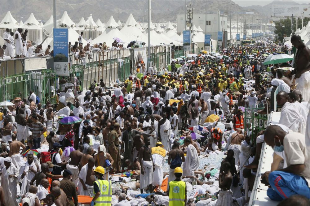 Muslim pilgrims and rescuers gather around the victims of a stampede in Mina, Saudi Arabia during the annual hajj pilgrimage on Thursday, Sept. 24, 2015. (AP)