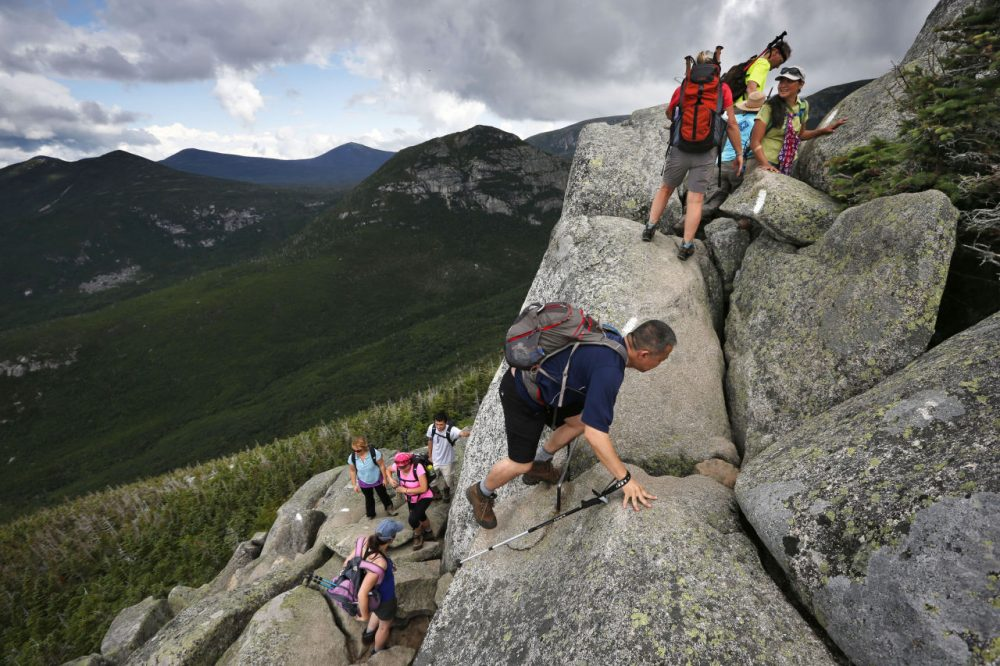 Day-hikers scramble over rocky boulders on the Appalachian Trail below the summit of Mt. Katahdin in Baxter State Park. (Robert F. Bukaty/AP)