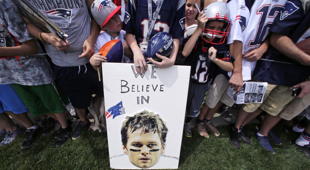 "Garry Emmons: ""If people applied the same intelligent scrutiny and research to public policy questions as they did to sports, would Team USA be doing a whole lot better?"" Pictured: New England Patriots fans stand behind a sign supporting quarterback Tom Brady during an NFL football training camp in Foxborough, Mass., in July, 2015. A federal judge deflated ""Deflategate"" Thursday, Sept. 3, 2015.  (Charles Krupa/AP)"