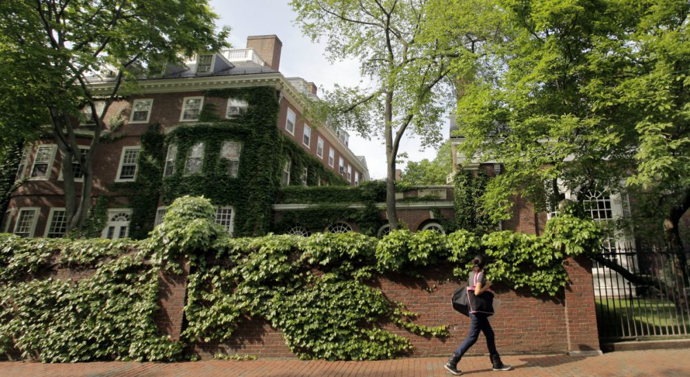 """Tom Keane: """"Are we in a time warp, somehow thrown back to the 1970s? Women in all-male bastions? Heavens-to-Betsy, what a shocking and bold move!"""" Pictured: A woman walks past Harvard University's Cambridge, Mass. campus. Last week, the Spee, a final club at Harvard, announced that it would admit women for the first time in its 163-year history. (Elise Amendola/AP)"""